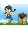 A girl playing beside the stump vector image