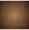 modern staples alphabet on wooden vector image