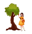 Young beautiful woman picking apples in the garden vector image