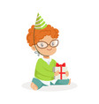 adorable baby boy wearing a green party hat vector image