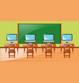 classroom with four computers on desk vector image