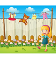 A backyard with hanging clothes and a young girl vector image