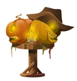 Carved pumpkins candles and cowboy hat on table vector image
