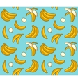 Seamless background of yellow bananas vector image