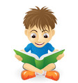 happy young boy reading vector image vector image