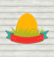 Vintage label with Easter egg on wooden background vector image