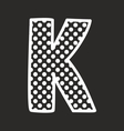 K alphabet letter with white polka dots on black vector image