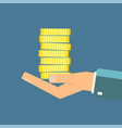 hand holding stack of coins vector image
