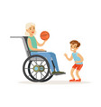 boy playing ball with grandmother sitting in a vector image