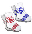 wool socks with red and blue reindeer pattern vector image