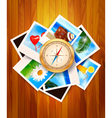 Travel photos and compass on wood background vector image