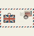 envelope with suitcase in colors of british flag