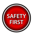 Red round safety first icon with white design vector image