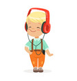 smiling little boy listening to music in vector image