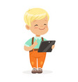 smiling little boy using digital tablet for vector image