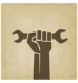 worker hand with wrench symbol vector image