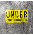 under construction sign on concrete wall texture vector image