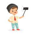 Cute little boy in fashionable clothes taking vector image