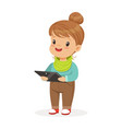 cute little girl standing and using digital tablet vector image