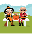 Elderly couple celebrating Halloween vector image