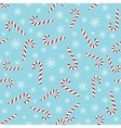 Christmas seamless blue pattern with candy canes vector image