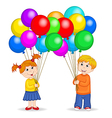 boy and girl holding balloons vector image
