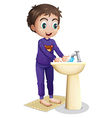 A boy washing his hands vector image vector image