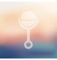 rattle icon on blurred background vector image