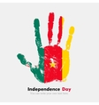 Handprint with the Flag of Cameroon in grunge vector image