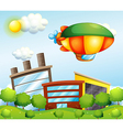 A tri-colored airship at the top of the buildings vector image