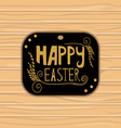 Golden Happy Easter lettering on wooden background vector image