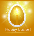 happy easter egg with a candle on gold background vector image