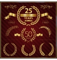 Anniversary golden emblems and decorative elements vector image