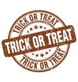 Trick or treat brown grunge round vintage rubber vector image