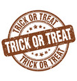 Trick or treat brown grunge round vintage rubber vector image