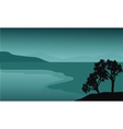 Silhouette of tree in the beach vector image