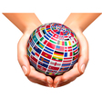 Flags of the world on a globe held in hands vector image