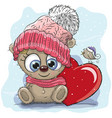 cute cartoon teddy in a knitted cap vector image
