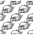 Cartoon skulls with tribal flames seamless pattern vector image