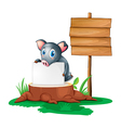 A pig holding an empty paper on a stump beside an vector image vector image