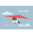 Businessman riding a hang glider vector image