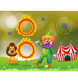 A ring of fire with a clown and a lion at the vector image vector image