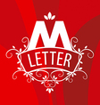 ornate letter M logo on a red background vector image