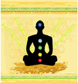 Yoga lotus pose Padmasana with colored chakra vector image