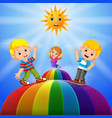 happy kids standing over the rainbow vector image