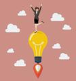 Business woman celebrating on a lightbulb idea vector image