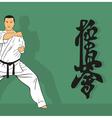 a man demonstrates karate next to a hieroglyph vector image