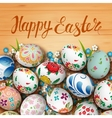 Easter eggs and flowers on the wooden table vector image