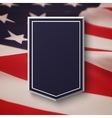 Blank blue shield on top of American flag vector image