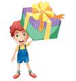 Boy holding box of present vector image